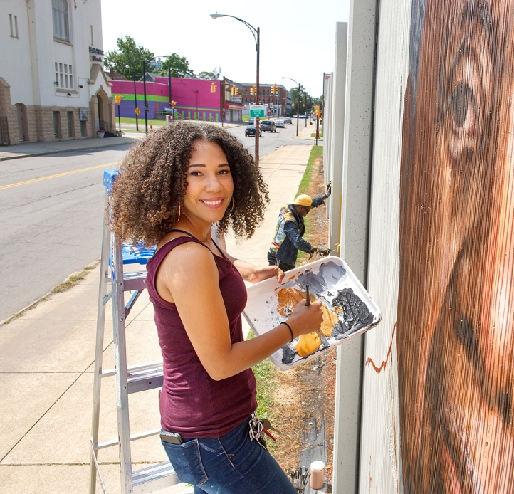Julia Bottoms-Douglas painting a city mural