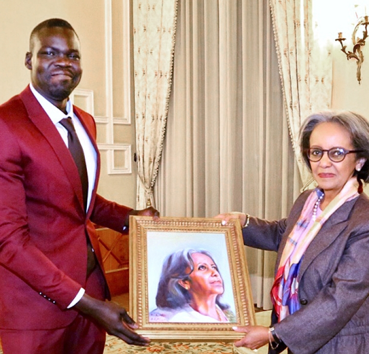 BuomKuoth Thot holding a painting with Ethiopian President