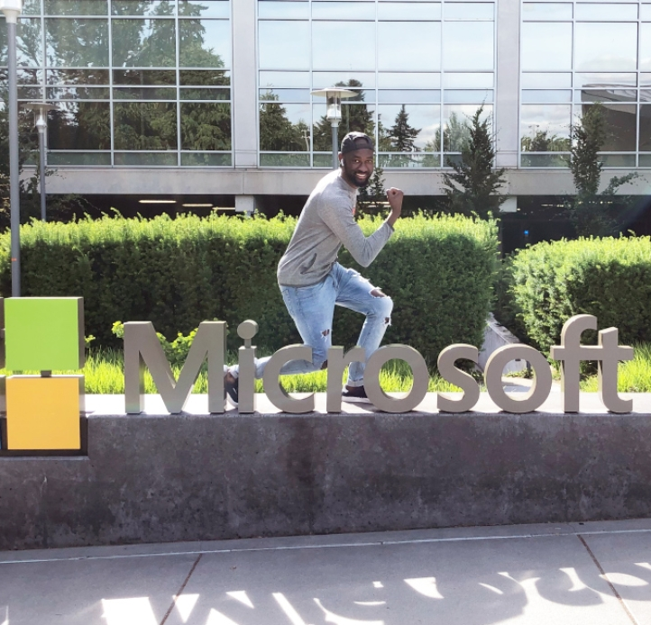 Mohamed Koanda posing on a Microsoft sign