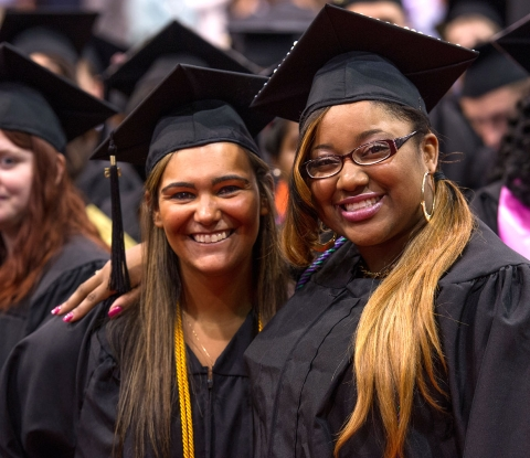 Smiling commencement students