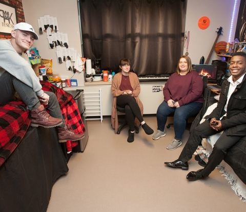 Students sitting in dorm room