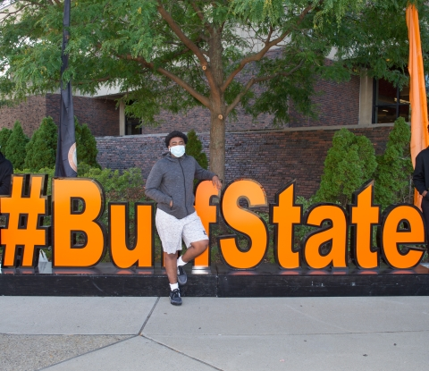 Students pose in front of #BuffState sign