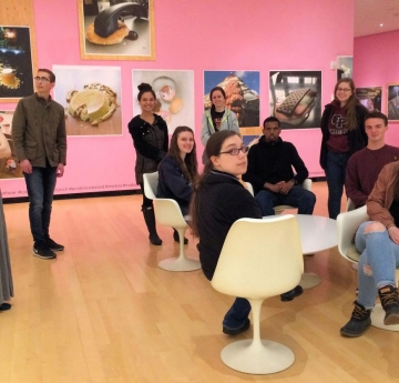 Honors students in an art gallery