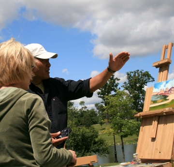 Student and faculty in an outdoor painting class