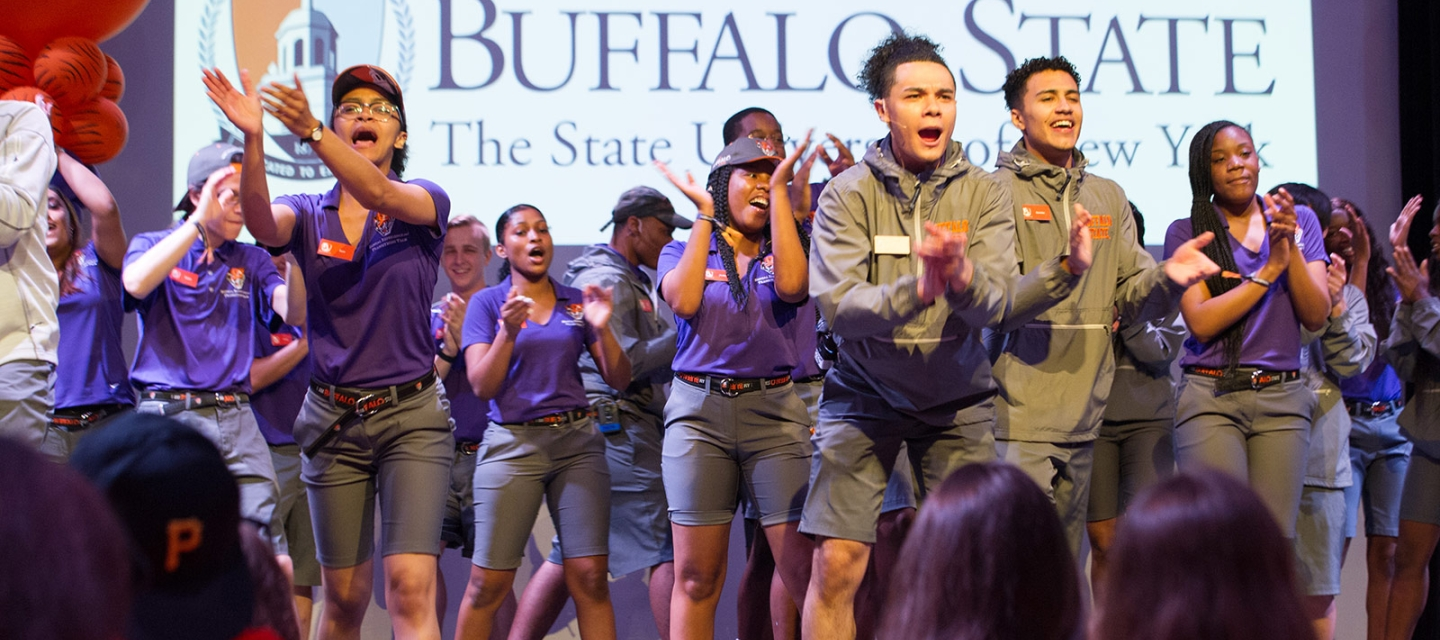 Orientation leaders perform on stage