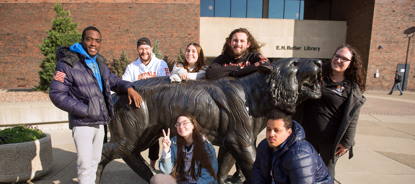 Students grouped around the bengal statue