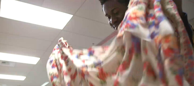 John Wesh picking up fabric