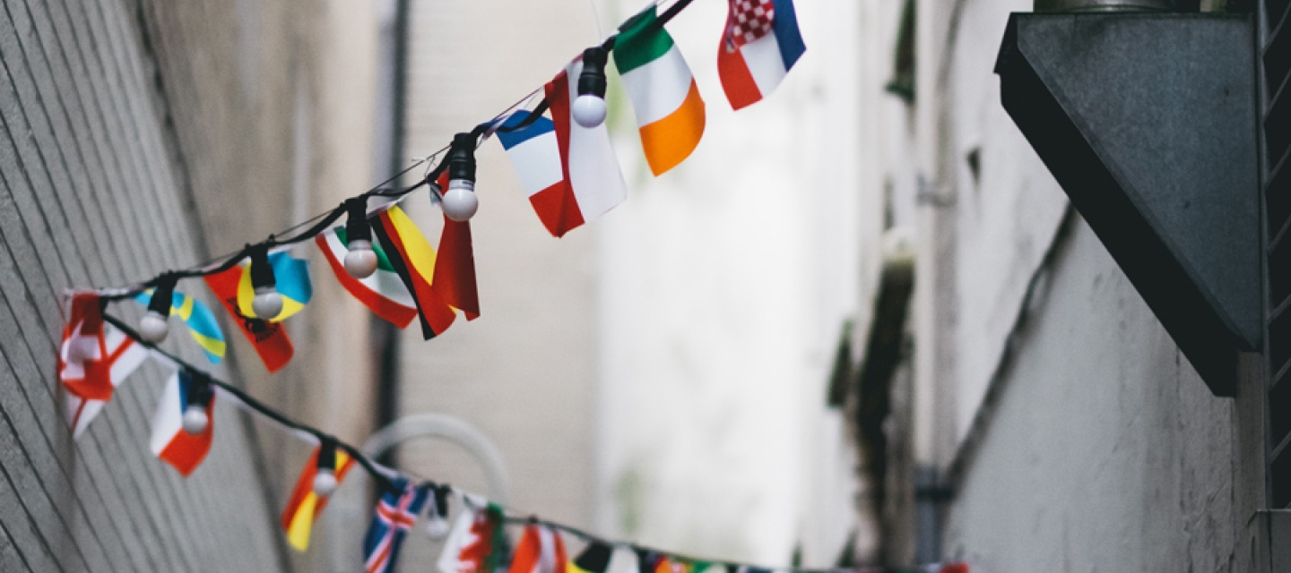 Bunting of international flags in an alley