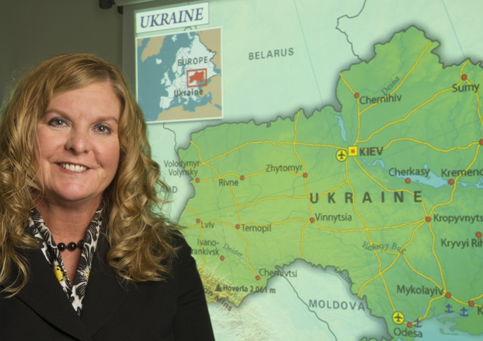 Kimberly Kline standing in front of a map of Ukraine