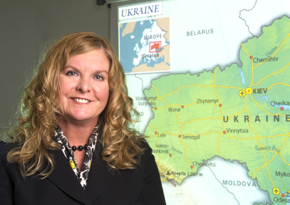 Kimberly A. Kline in front of map of Ukraine
