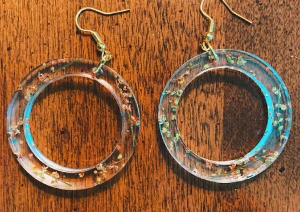Pair of handcrafted earrings on a table