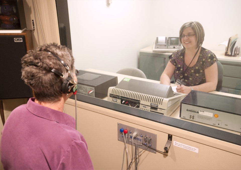Client in the Speech-Language-Hearing Clinic wearing headphones